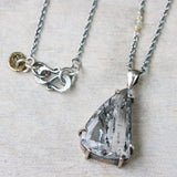 Tear drop faceted of super 7 pendant  in silver bezel and polished silver prongs setting