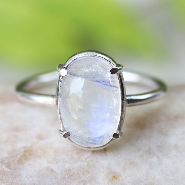 Moonstone cabochon in prongs and sterling silver prongs setting with silver band - Metal Studio Jewelry