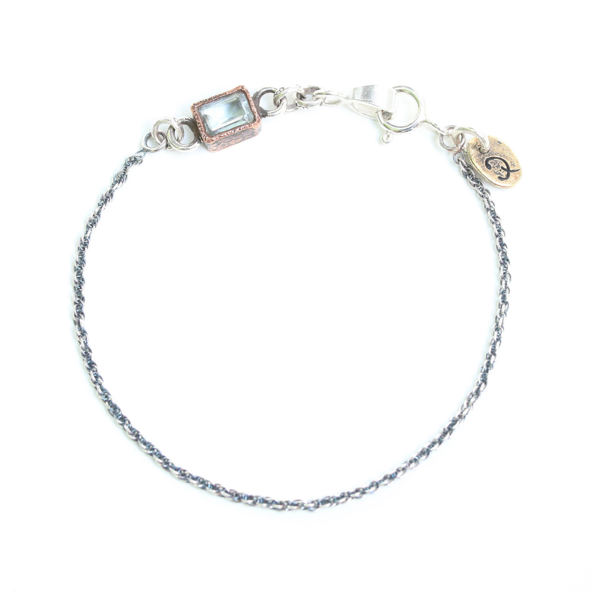 Octagon faceted blue topaz bracelet in copper bezel setting and sterling silver oxidized double rope chain