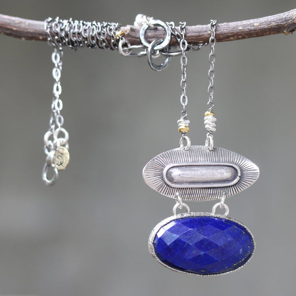 Oval faceted Lapis pendant necklace in silver bezel setting with oval silver engraving textured on sterling silver oxidized chain - Metal Studio Jewelry