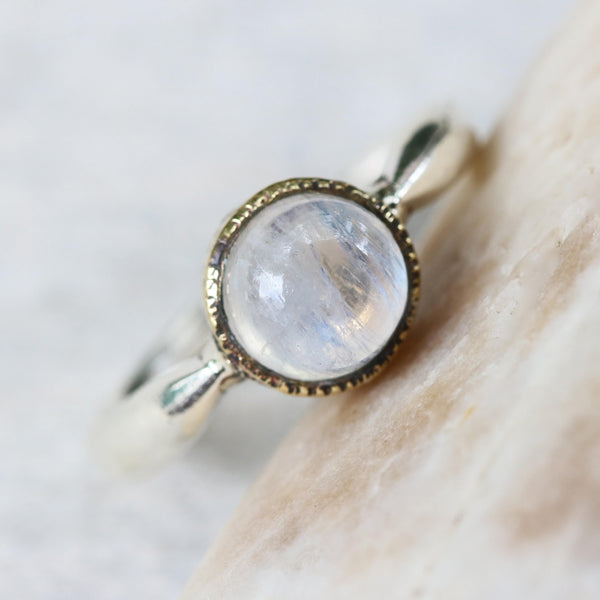 Round cabochon moonstone ring in brass bezel setting with sterling silver high polish finished band - Metal Studio Jewelry