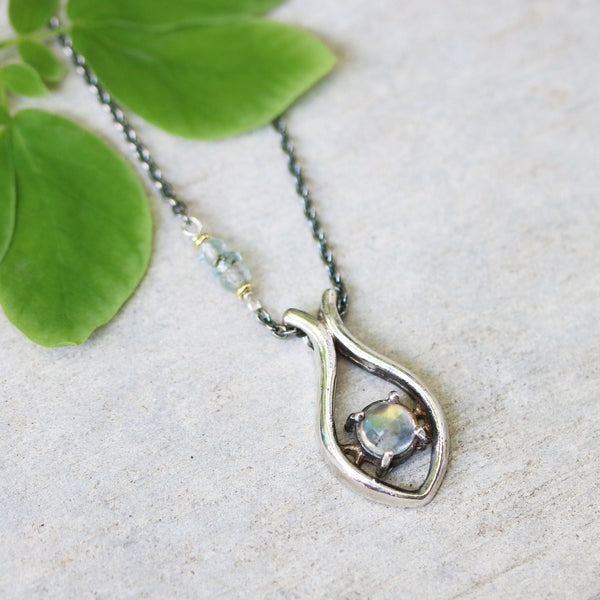 Silver fish shape necklace and faceted moonstone at the center with aquamarine beads secondary on oxidized sterling silver chain - Metal Studio Jewelry