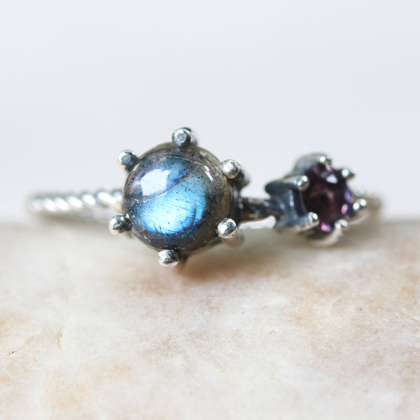 Round cabochon labradorite ring in silver bezel and prongs setting and purple tourmaline on the side with sterling silver twist design band - Metal Studio Jewelry