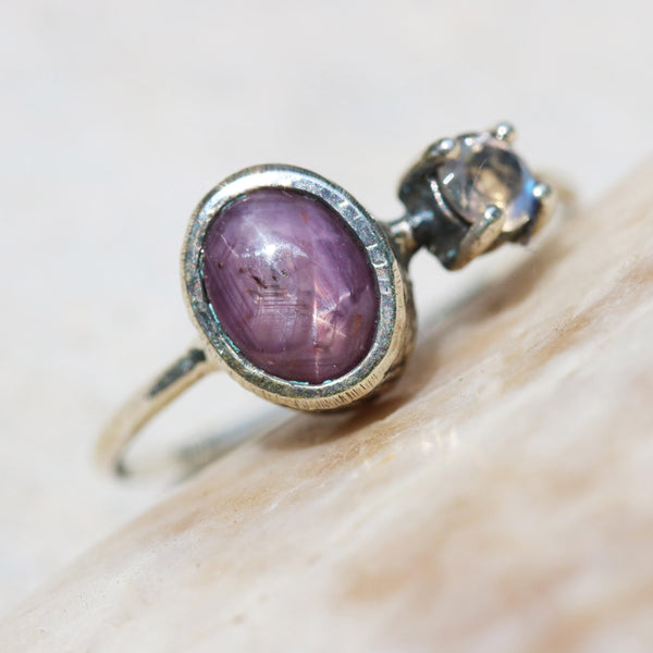 Oval cabochon star ruby ring in silver bezel setting with tiny moonstone on the side with sterling silver high polished band - Metal Studio Jewelry