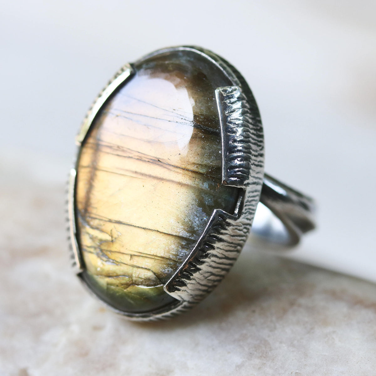 Labradorite and silver cocktail ring with stunning oval labradorite cabochon gemstone