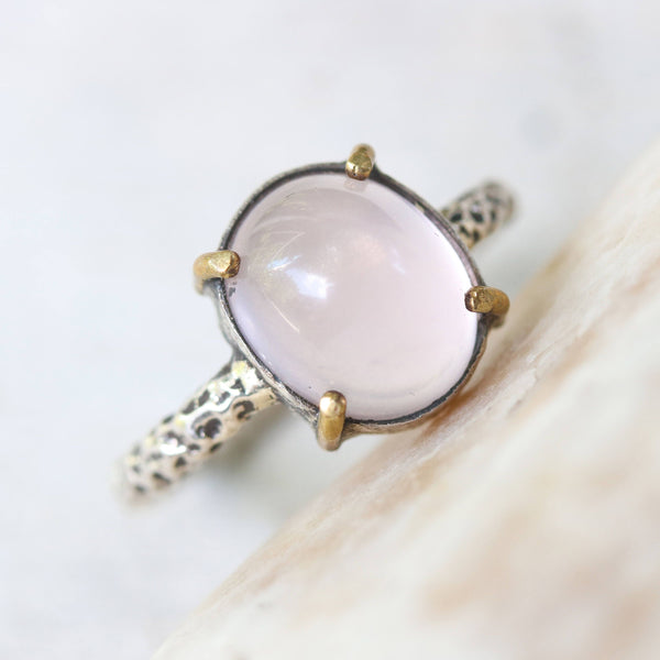 Rose quartz cocktail ring with silver heavily textured setting and brass accent prongs - Metal Studio Jewelry