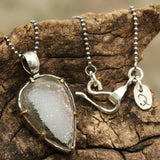 Gray raw druzypendant necklace in silver bezel and brass prongs setting and oxidize
