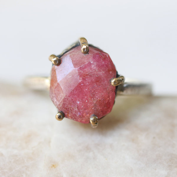 Pink sapphire ring in silver and brass prongs setting with sterling silver band
