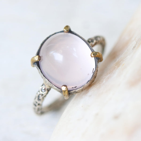 Round cut rose quartz cabochon statement ring with heavily textured silver band