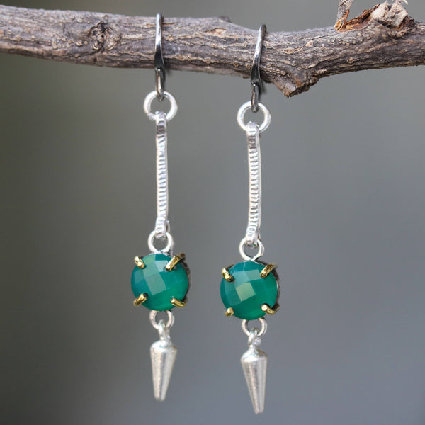 Round faceted green onyx earrings in silver bezel and brass prong setting with silver cone and  oxidized sterling hooks - Metal Studio Jewelry
