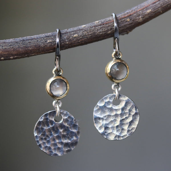 Round cabochon moonstone earrings in brass bezel setting with circle silver hammer textured and oxidized sterling silver hooks - Metal Studio Jewelry