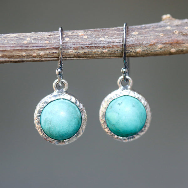 Round cabochon blue turquoise earrings in silver bezel setting with oxidized sterling silver hooks style