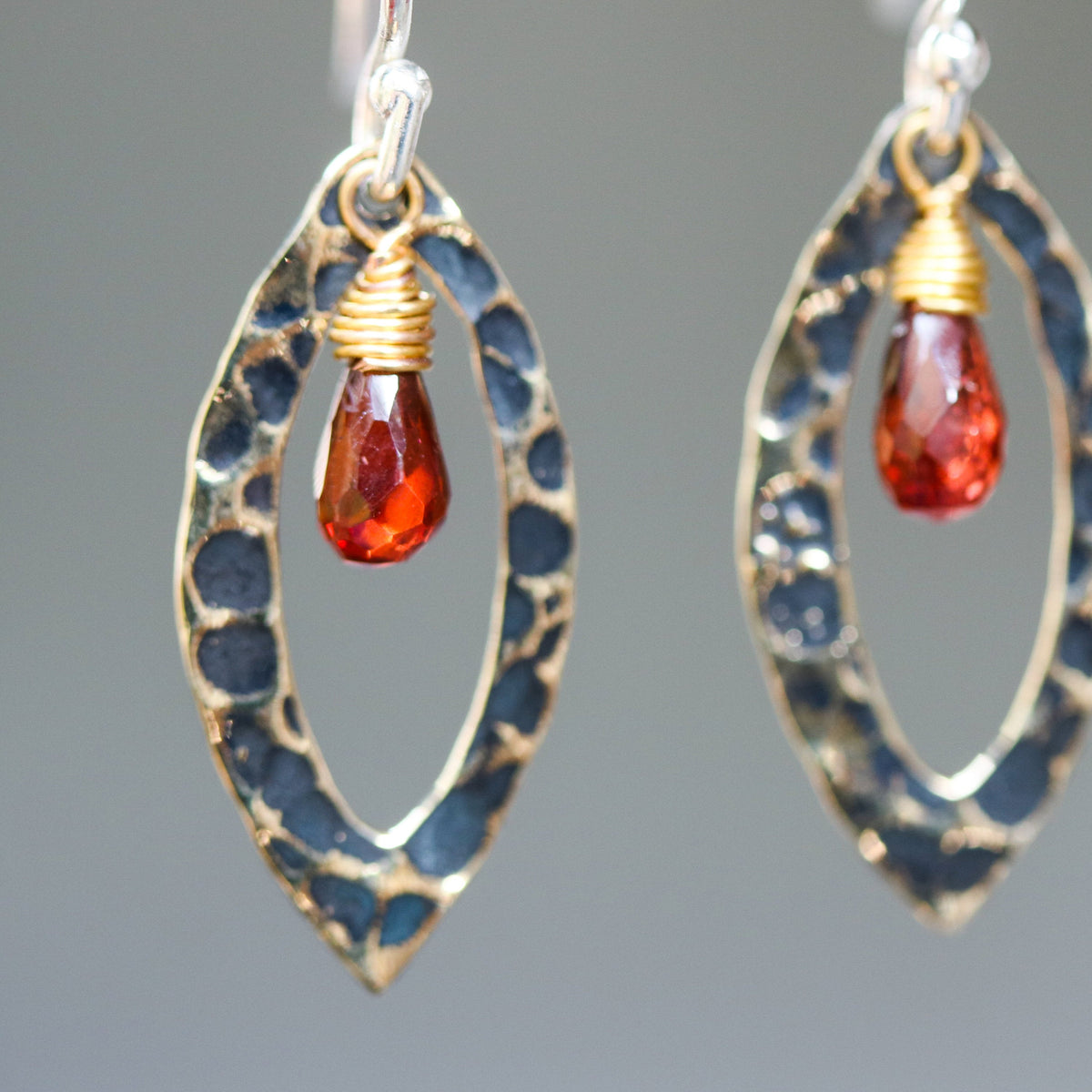 Garnet earrings and oxidized brass marquis shape in hammer textured on sterling silver hook style(FBA)