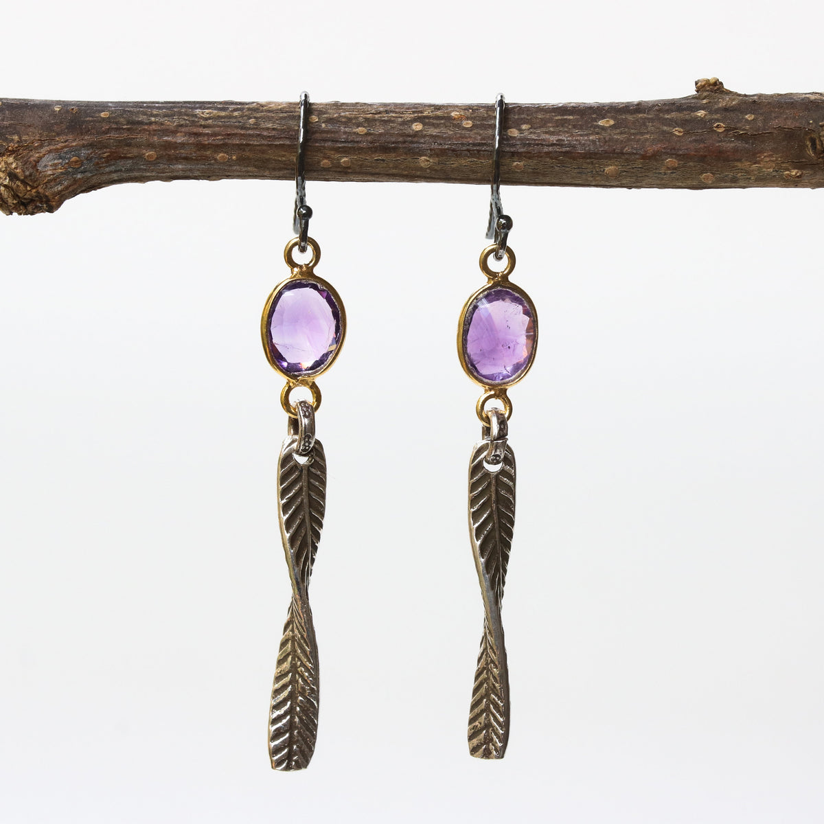 Amethyst earrings in gold plated bezel setting and silver leaf on sterling silver hook style