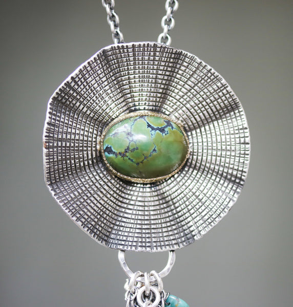 Flower pendant necklace with green turquoise in brass bezel setting and silver leaf and turquoise set with chain on silver oxidized chain