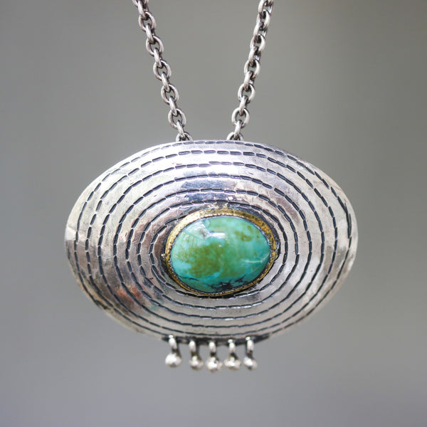 Turquoise pendant necklace in brass bezel setting in silver engraving oval shape and silver beads on sterling silver oxidized chain