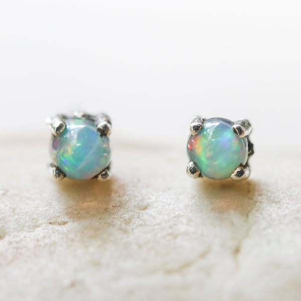 Sterling silver stud earrings with opal cabochon in prongs setting with sterling silver post and backing