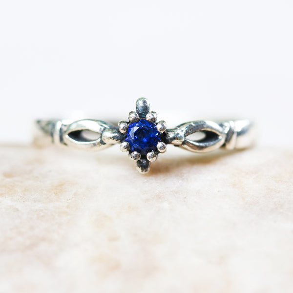 Round faceted blue sapphire ring in silver prongs setting with sterling silver high polished band - Metal Studio Jewelry