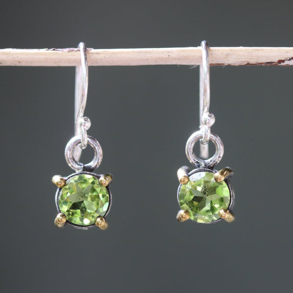 Earrings round faceted peridot in silver bezel and brass prongs setting with sterling silver hooks style