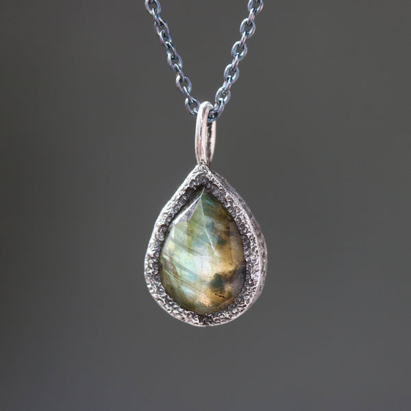 Teardrop faceted labradorite gemstone pendant necklace in silver bezel setting and labradorite beads on the side with silver chain
