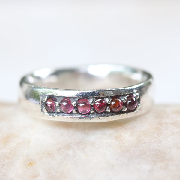 Modern wedding ring design 6 tiny round cabochon garnet in silver bezel setting with high polished sterling silver band