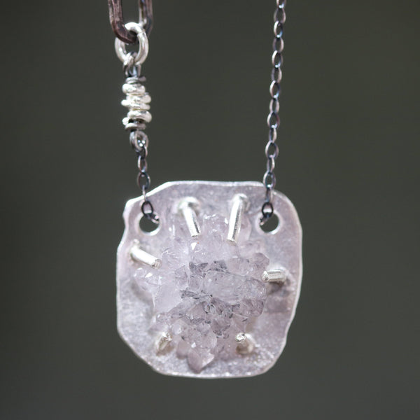 Light purple druzy pendant necklace in silver prongs setting with silver oval shape and silver beads secondary on sterling silver chain
