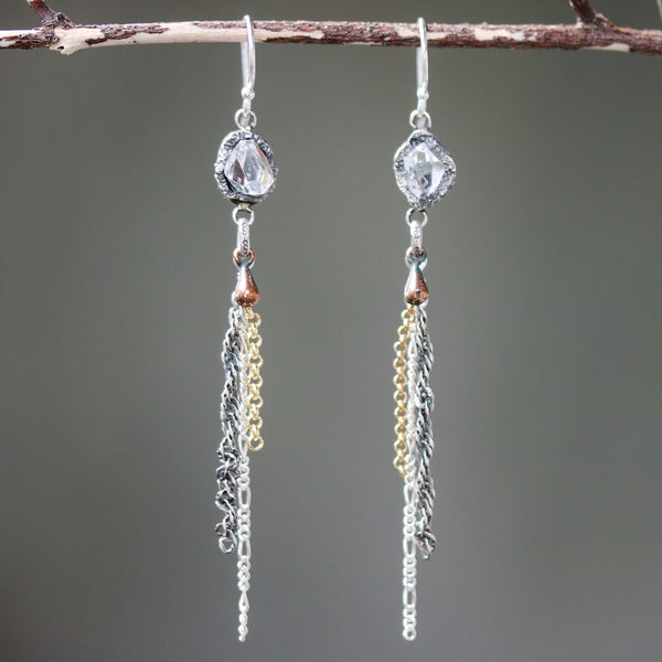 Earrings,Clear quartz crystal in silver bezel setting with silver chain and copper teardrop on sterling silver hooks style
