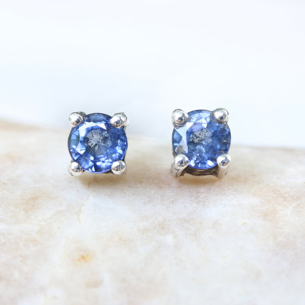 Sterling silver stud earrings with faceted blue sapphire in prongs setting with sterling silver post and backing