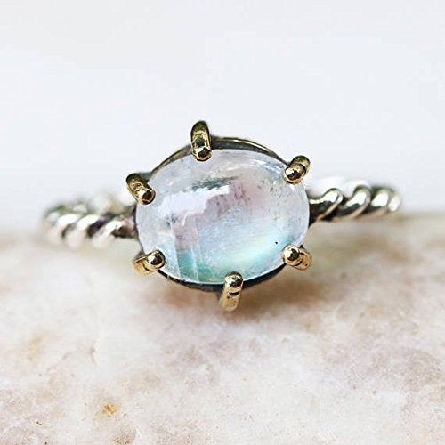 Oval moonstone ring in silver bezel and brass prongs setting with sterling silver oxidized twist design band