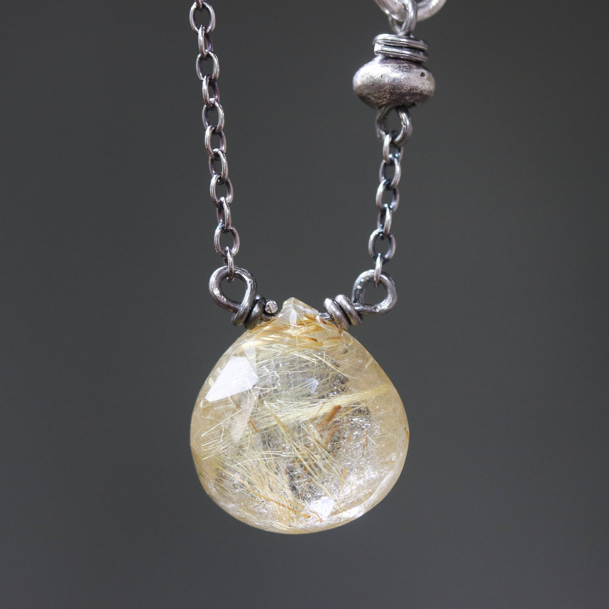 Teardrop faceted golden Rutilated quartz pendant necklace with silver ring secondary on oxidized sterling silver cable chain