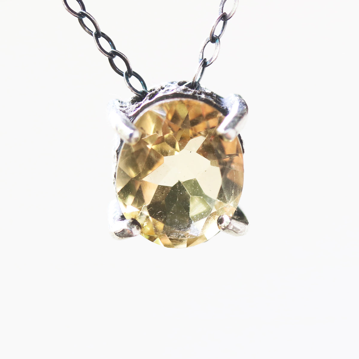 Oval faceted Citrine pendant necklace in silver bezel and prongs setting with yellow multi-sapphire beads secondary on oxidized silver chain