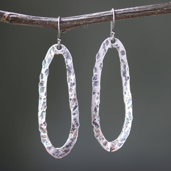 Silver oxidized hammer textured peanut shape hoop earrings with sterling silver hooks - Metal Studio Jewelry