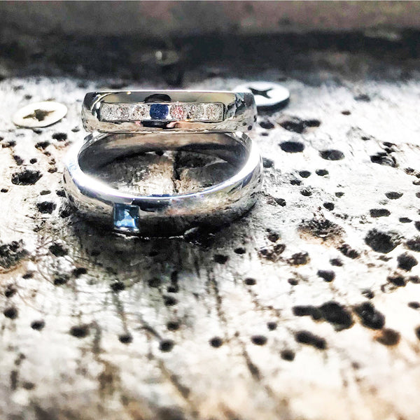Wedding band set his and hers with blue sapphire and diamonds on white gold in high polished band