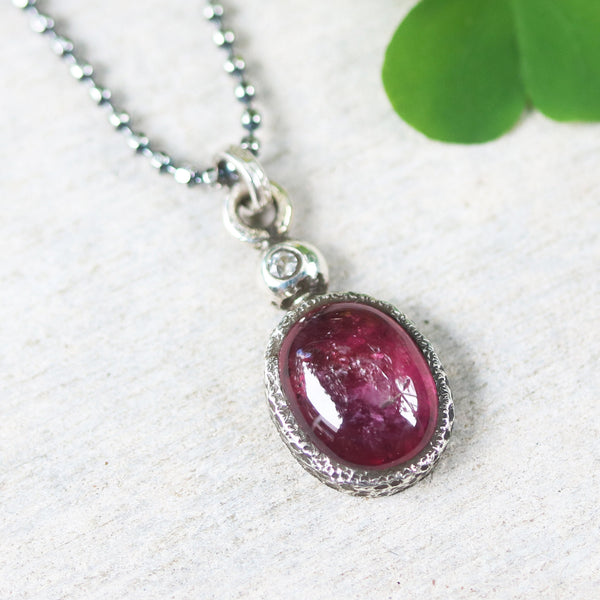 Red ruby necklace in silver prongs setting with tiny diamond on the top and oxidized sterling silver ball style chain