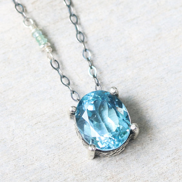Oval Blue topaz pendant necklace in silver bezel and prongs setting with aquamarine beads secondary on oxidized sterling silver chain - Metal Studio Jewelry