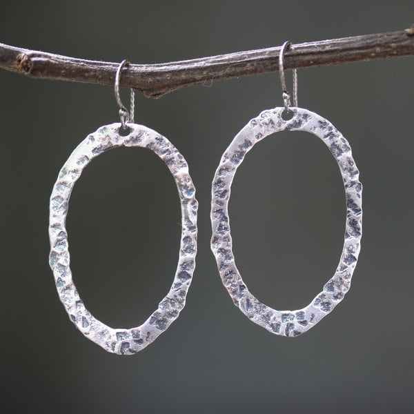 Silver oxidized hammer textured oval hoop earrings with sterling silver hooks