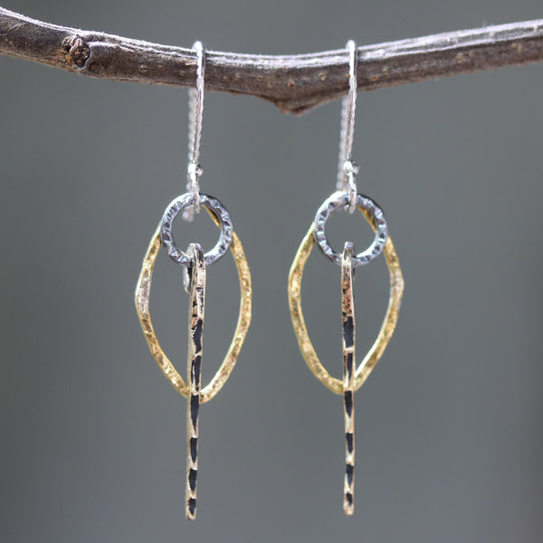 Brass Marquis shape earrings with silver circle and brass sticks on oxidized sterling silver hooks