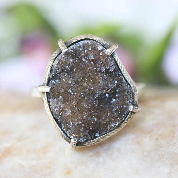 Dark brown free-form shape druzy ring in silver bezel and prongs setting