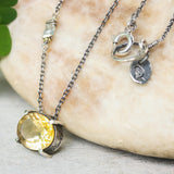 Tiny oval faceted yellow Citrine pendant necklace in silver bezel and prongs setting