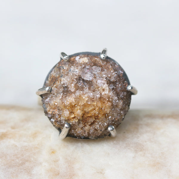 Yellow/brown druzy ring in silver bezel and prongs prongs setting with sterling silver square design in high polish finished band