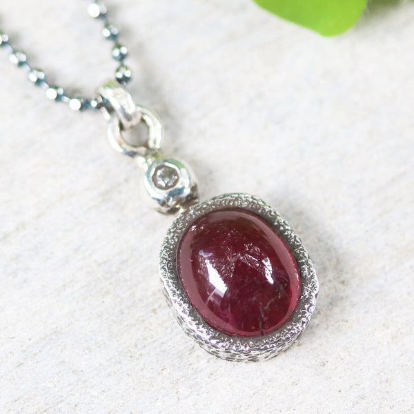 Ruby in red color pendant necklace in silver prongs setting with tiny diamond on the top and oxidized sterling silver ball style chain