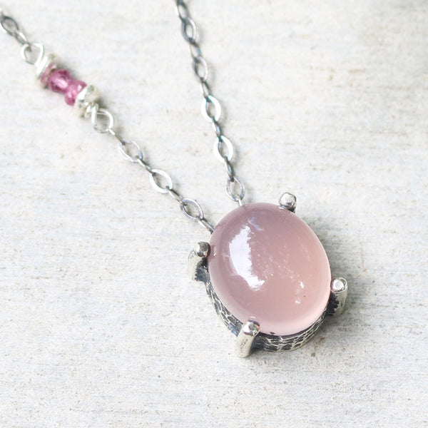 Oval cabochon rose quartz necklace in silver bezel and prongs setting with pink multi-sapphire beads secondary on oxidized silver chain - Metal Studio Jewelry