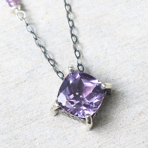 Cushion Amethyst pendant necklace in silver bezel and prongs setting with amethyst beads secondary on oxidized sterling silver chain - Metal Studio Jewelry