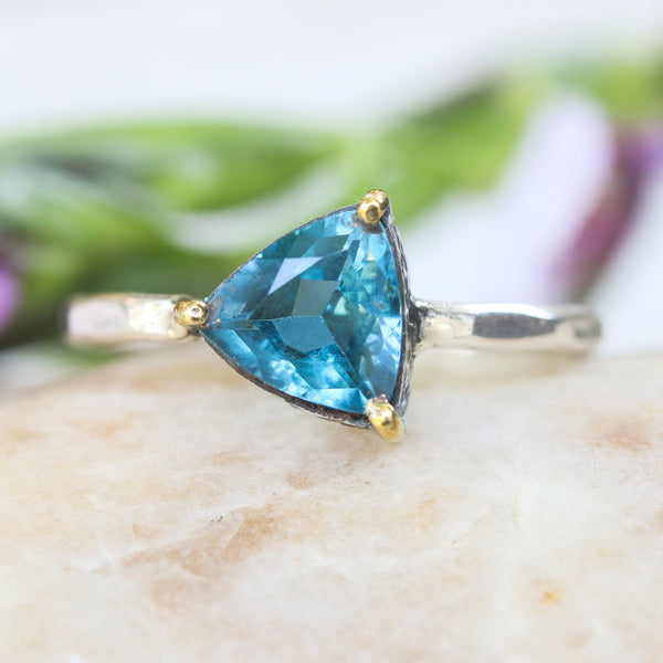 Trillion London blue topaz ring in silver bezel and brass prongs setting