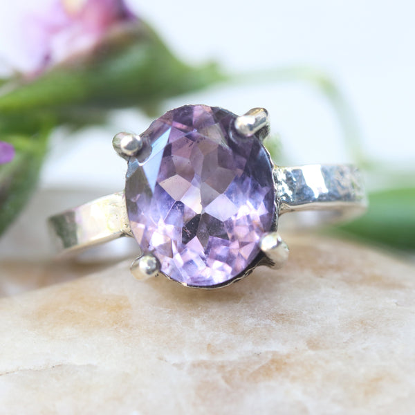 Oval faceted amethyst ring in silver bezel and prongs setting with sterling silver hammer texture design band