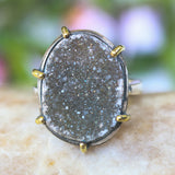 Sterling silver band ring with oval gray druzy quartz in silver bezel and brass prongs setting