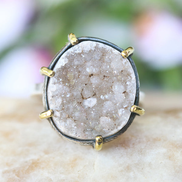 Oval light gray Druzy ring in silver bezel and prongs setting
