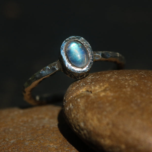 Dainty oval moonstone ring in silver bezel setting with oxidized texture sterling silver band
