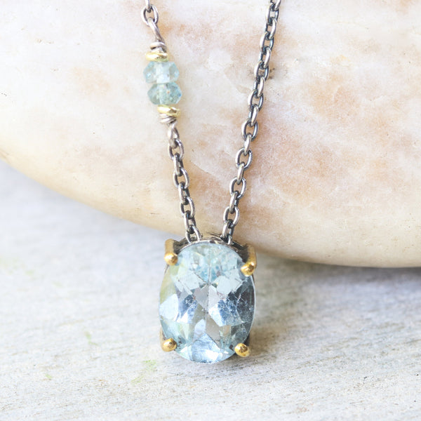 Blue topaz necklace in silver bezel and brass prongs setting with sterling silver cable chain