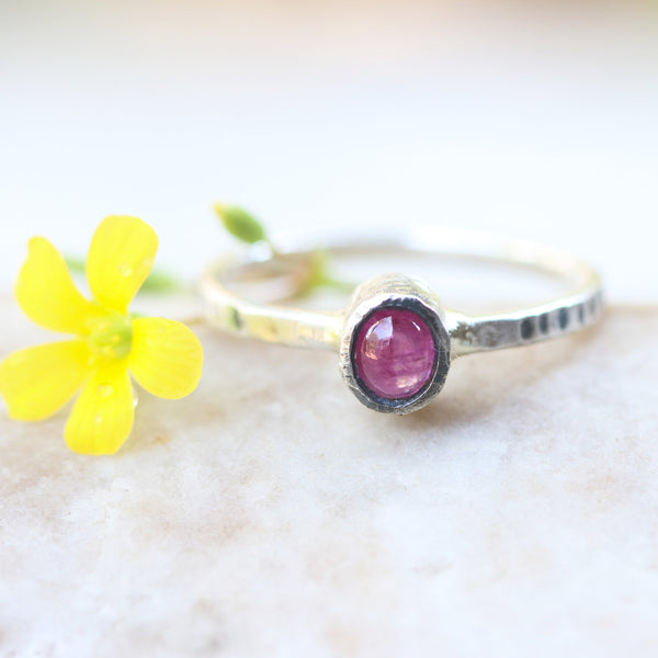 Oval cabochon pink sapphire in silver bezel setting with oxidized sterling silver texture design band - Metal Studio Jewelry